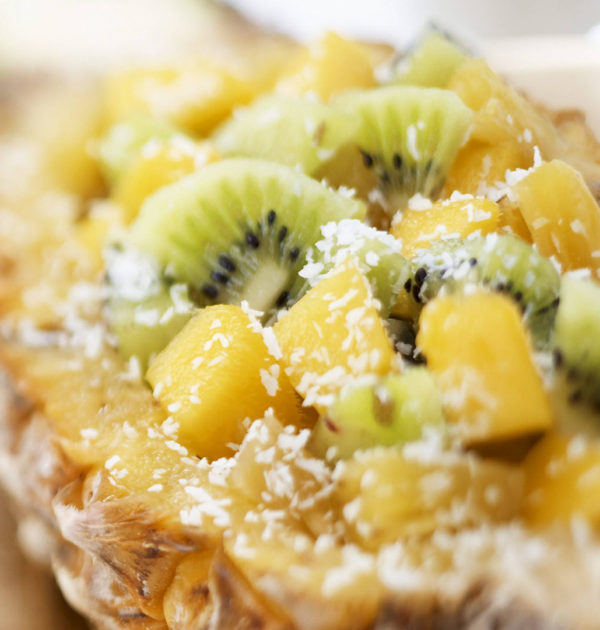 Pineapple with kiwi fruit and grated coconut